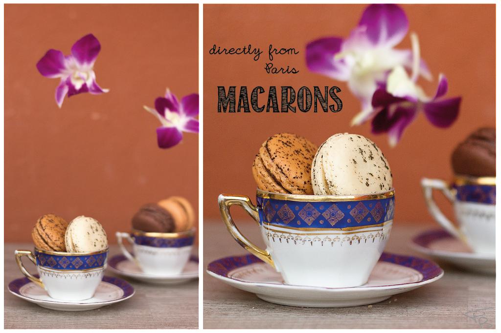 macarons in una piccola tazzina da caffe' con fiori di orchidea viola che cadono delicatamente dall'alto